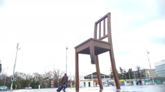 Panorama of Broken Chair monument and Palace of Nations in Geneva, Switzerland Stock Footage