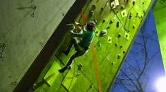 Rock climber on the training wall. Motivation. Mountain Stock Footage