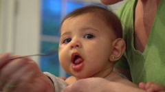 Little baby being spoon fed Stock Footage