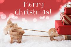 Reindeer With Sled, Red Background, Text Merry Christmas Kuvituskuvat