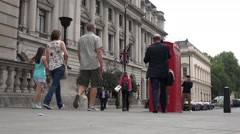 4K London Red English Telephone Cabin, People Tourists Walking in UK Streets Stock Footage