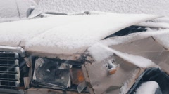 Broken in accident car covered with snow Stock Footage