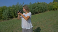 Woman taking a photo of Prague Stock Footage