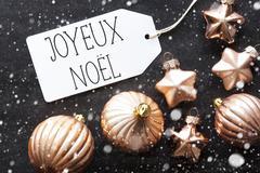 Bronze Balls, Snowflakes, Joyeux Noel Means Merry Christmas Stock Photos