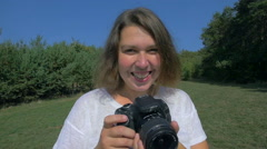 Woman smiling and taking photo Stock Footage