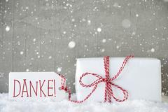 Gift, Cement Background With Snowflakes, Danke Means Thank You Stock Photos