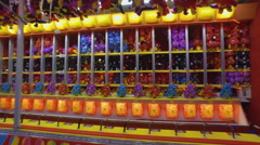 Fall Fair Medium shot dollies in on stuffed toys at a carnival game sation Stock Footage