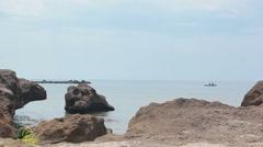 Kayak runs on stones against the sea Stock Footage