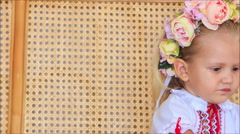 Closeup Little Blond Girl in Garland Drinks Juice Stock Footage