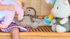 Little Girl in Vyshyvanka Plays with Toys on Armchair Stock Footage