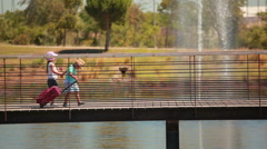 Little kids cross bridge Stock Footage