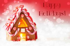 Gingerbread House, Red Background, Text Happy Holidays Stock Photos