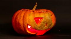 Spinning pumpkin jack o lantern Stock Footage