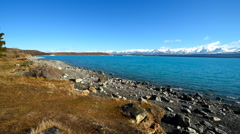 Lake Pukaki with bright blue, turquoise water in winter Stock Footage