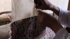 Carpet weaving. Man weaves a carpet Kashmir at weaving factory. Srinagar, India Stock Footage