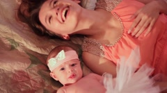 Mother with baby lying on bed Stock Footage