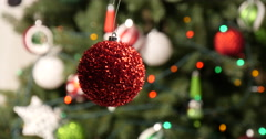 Spining Christmas decorated red ball Stock Footage