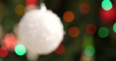 Focusing of christmas snow ball at tree Stock Footage
