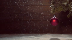 Christmas ball  lantern with a burning candle and a fir branch on a wooden ba Stock Footage
