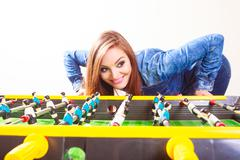 Woman playing table football game Kuvituskuvat
