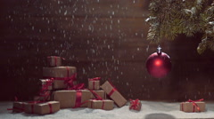 Christmas ball  and a fir branch with gift box on a wooden background with sn Stock Footage