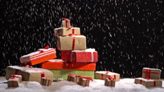 Christmas  background  with gift box on snow with  snowfall Stock Footage