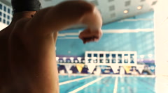 Rear view closeup of athlete swimmer stretching body before swim. Stock Footage