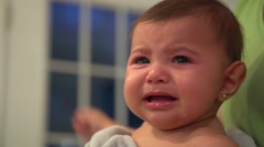 Sad and tired infant sobs Stock Footage