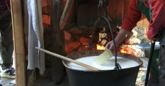 Cheesemaking of Mountain Cheese in a log cabin. Stock Footage