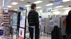Motion of mother bring son having flu shot at pharmacy section Stock Footage
