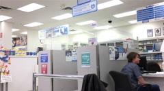 Pan shot of young man having flu shot at pharmacy section Stock Footage