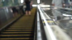 Japanese escalator manner to stand on one side for rush people to walk fast Stock Footage