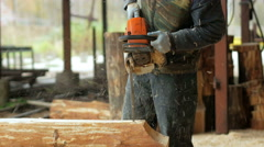 Man makes curly cutting wood Chainsaw. The log will be part of the future of the Stock Footage