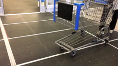 Shopping cart concept with customer returning trolley inside Walmart store Stock Footage
