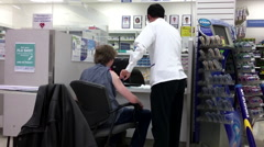 Motion of young man having flu shot at pharmacy section Stock Footage