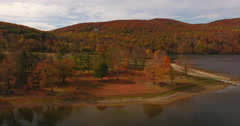 Squantz Pond New Fairfield CT foliage truck right Stock Footage