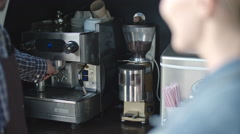 Male Barista Grounding Coffee Stock Footage