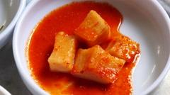 Pick up KKAKDUGI with chipsticks. Sliced radish kimchi Stock Footage