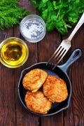 Chicken cutlets with spice and fresh greens Stock Photos