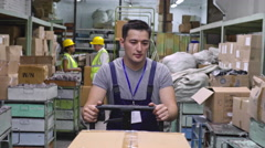 Male Worker with Warehouse Trolley Stock Footage