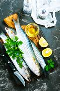 Raw fish with aroma spice on a table Stock Photos