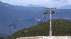 Empty cableway ski lift chairs Stock Footage