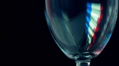 Red wine being pored into wineglass with French flag-like highlight. Winemaking Stock Footage