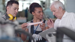 Workers Discussing Insole on Shoe Factory Stock Footage