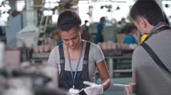 Workers on Conveyor in Shoe Factory Stock Footage