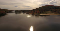 Squantz Pond New Fairfield CT sun glare flyover Stock Footage