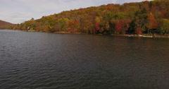Squantz Pond New Fairfield CT shoreline low ascend Stock Footage