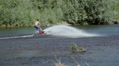 Wakeboarding on the river Stock Footage