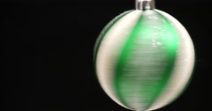 Spinning green christmas striped ball Stock Footage
