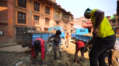 A few man clean street after earthquake occurred on April 25, 2015 in Bhaktapur Stock Footage